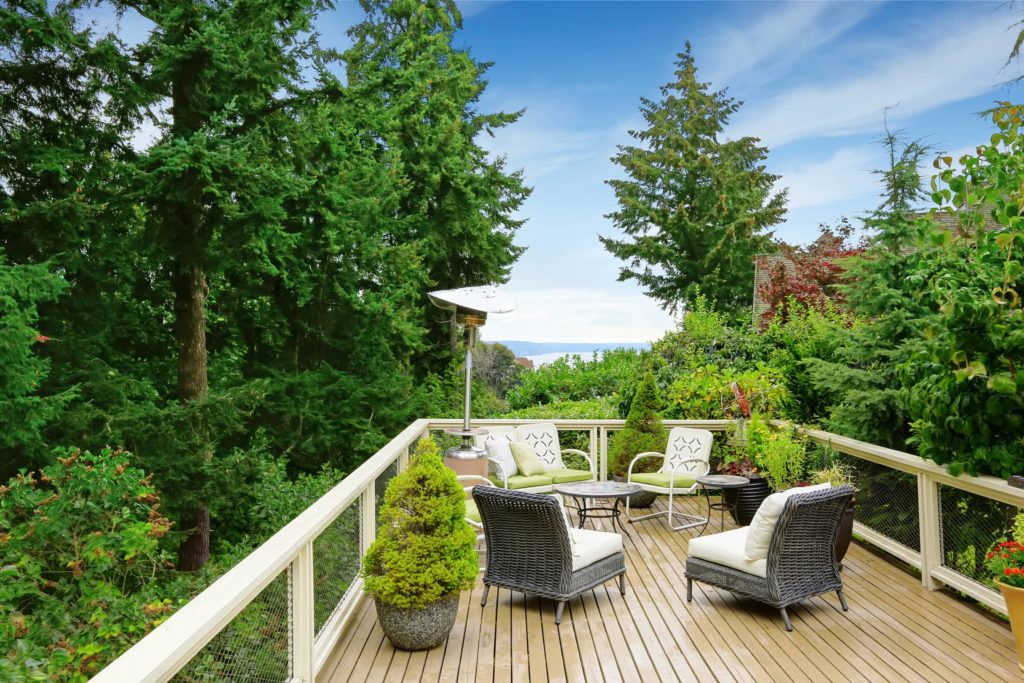 An image of an elevated deck with patio furnature.