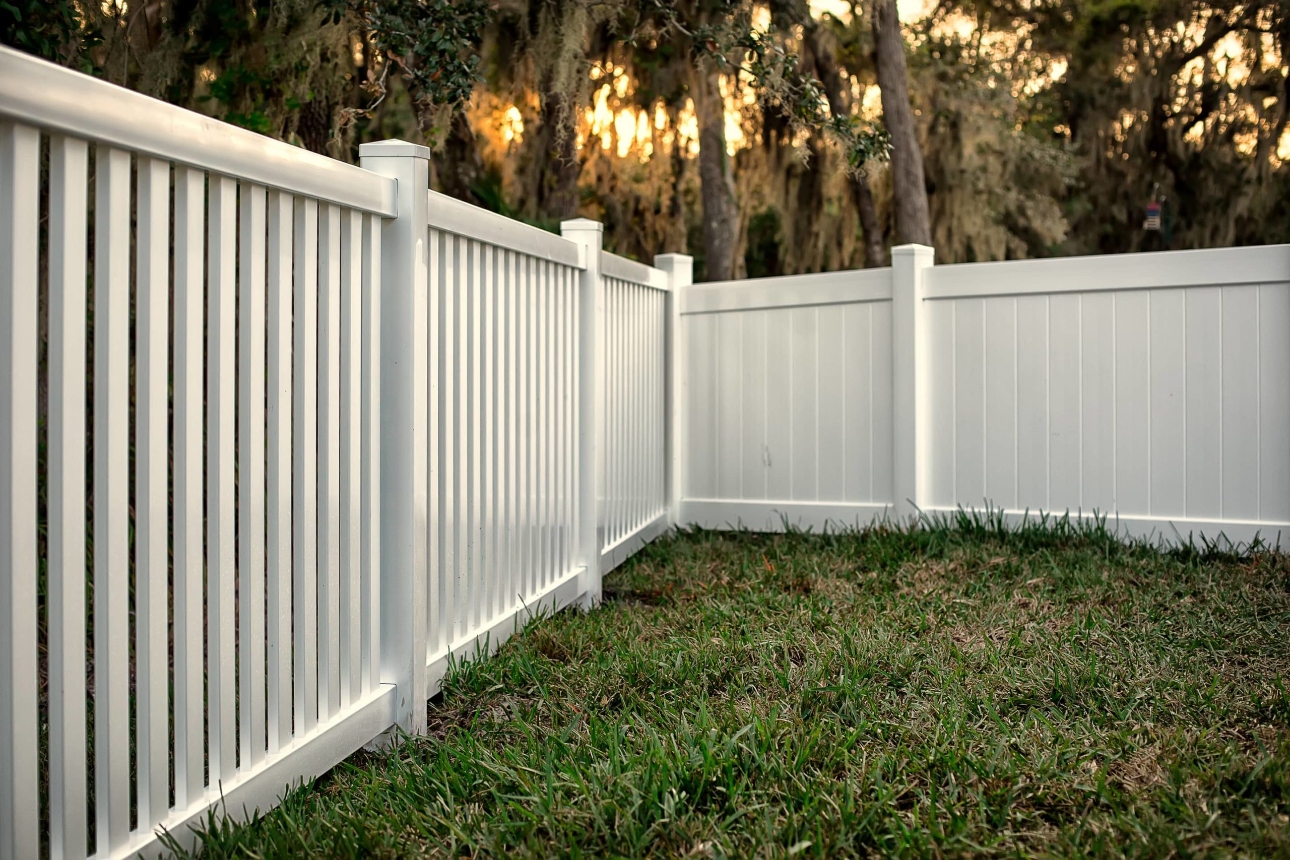This image shows a white wooden fence for a backyard.